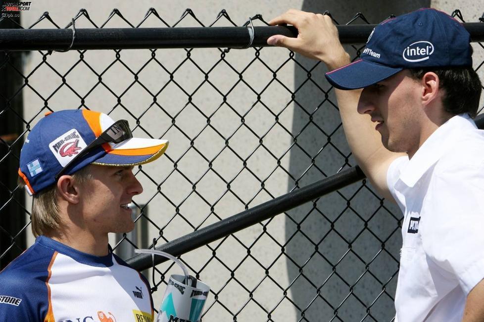 Heikki Kovalainen (Renault) und Robert Kubica (BMW Sauber F1 Team)