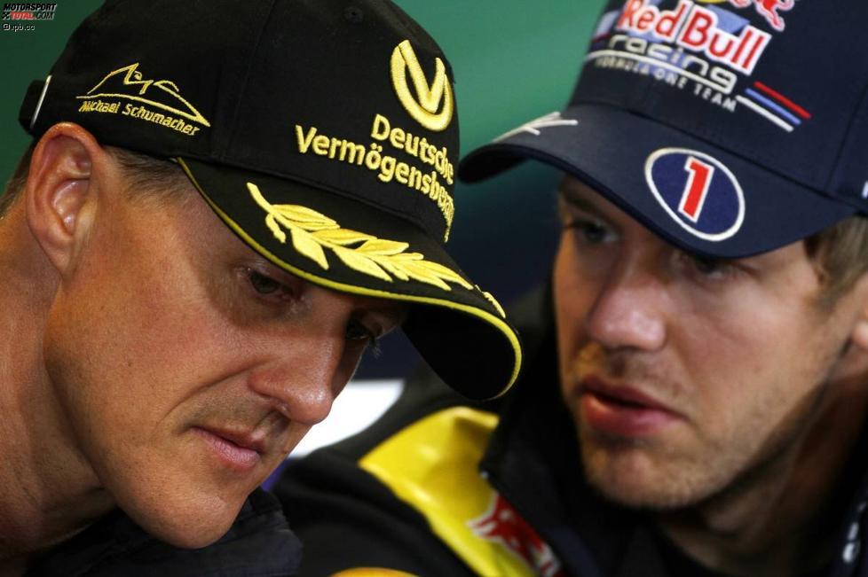 Michael Schumacher (Mercedes) Sebastian Vettel (Red Bull)