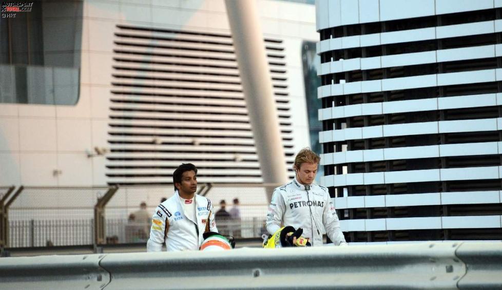 Narain Karthikeyan (HRT) und Nico Rosberg (Mercedes)
