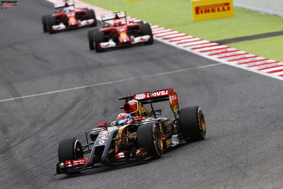 Romain Grosjean (Lotus), Kimi Räikkönen (Ferrari) und Fernando Alonso (Ferrari)