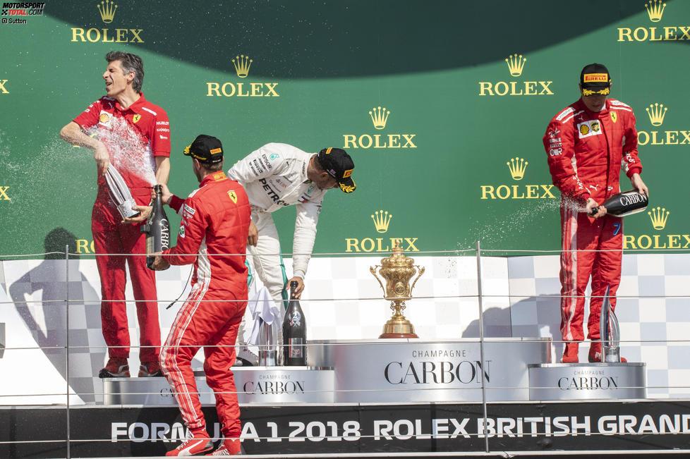 Sebastian Vettel (Ferrari), Lewis Hamilton (Mercedes) und Kimi Räikkönen (Ferrari)