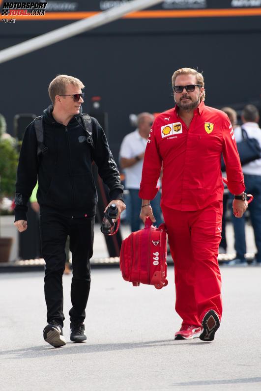 Kimi Räikkönen (Alfa Romeo) und Gino Rosato (Ferrari)