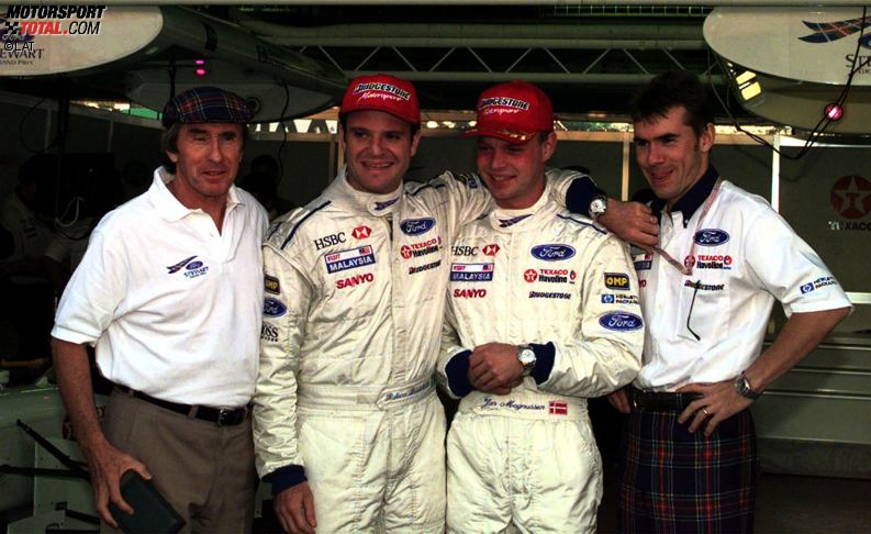 1997: Ende der 90er Jahre bringt Ex-Weltmeister Jackie Stewart sein eigenes Formel-1-Team und damit auch den Standort Milton Keynes auf die Landkarte. Mit dem typisch schottischen Muster auf dem Auto sind die Boliden ein Unikat im Zirkus. Doch der Bolide, den Rubens Barrichello und Jan Magnussen bewegen ist ein Muster an Unzuverlässigkeit, doch bei einem von nur acht Zielankünften des Teams fährt Barrichello in Monaco auf Rang zwei
