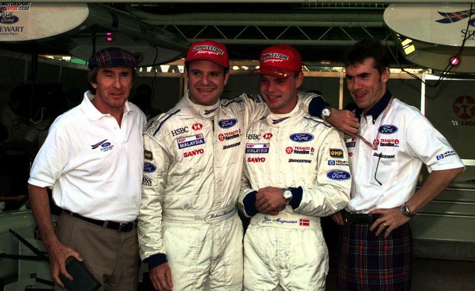 1997: Ende der 90er Jahre bringt Ex-Weltmeister Jackie Stewart sein eigenes Formel-1-Team und damit auch den Standort Milton Keynes auf die Landkarte. Mit dem typisch schottischen Muster auf dem Auto sind die Boliden ein Unikat im Zirkus. Doch der Bolide, den Rubens Barrichello und Jan Magnussen bewegen, ist ein Muster an Unzuverlässigkeit. Doch bei einem von nur acht Zielankünften des Teams fährt Barrichello in Monaco auf Rang zwei.