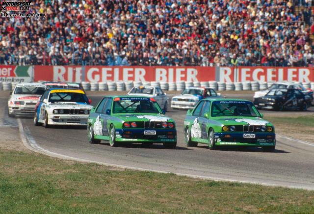 #10: Alpina M3, 1988. Das Michelin-Männchen auf grünem Untergrund. So fuhren Christian Danner (links) und Peter Oberndorfer vor fast 30 Jahren für Alpina in der DTM. Und für uns ist das der Startschuss in unsere Top 10 der legendären DTM-Autodesigns!