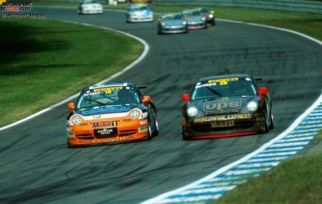 Nach Jahren im Kartsport und in der Formel Ford wird Timo Bernhard 1999 Porsche-Junior. Der Durchbruch gelingt ihm im Jahr 2001 mit dem Gewinn des Porsche-Carrera-Cups. Hier duelliert er sich in Hockenheim mit Stephane Ortelli.