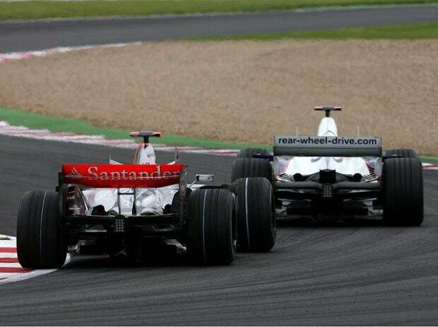 Nick Heidfeld vor Fernando Alonso