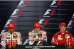 Lewis Hamilton, Fernando Alonso (McLaren-Mercedes) und Kimi Räikkönen (Ferrari)