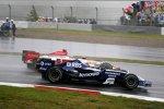 Nico Rosberg (Williams) und Takuma Sato (Super Aguri)