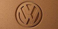 Volkswagen-Logo im Sand