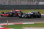 Heikki Kovalainen (McLaren-Mercedes) und Nico Rosberg (Williams)