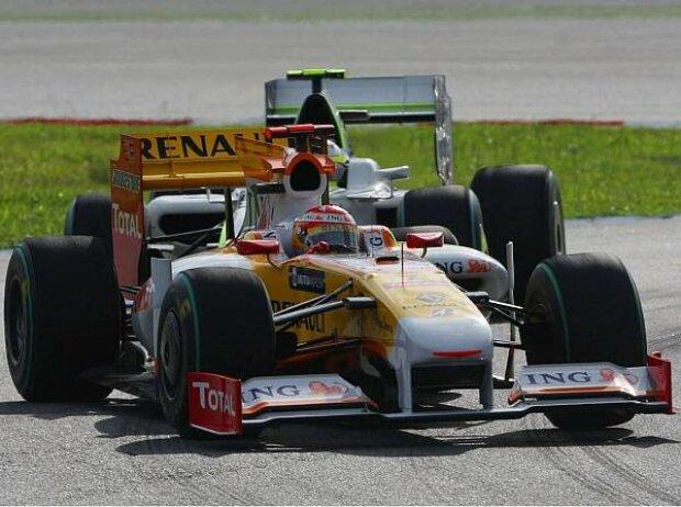 Fernando Alonso vor Rubens Barrichello