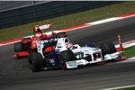 Robert Kubica (BMW Sauber F1 Team) vor Kimi Räikkönen (Ferrari)