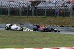 Sebastian Vettel (Red Bull) und Rubens Barrichello (Brawn)