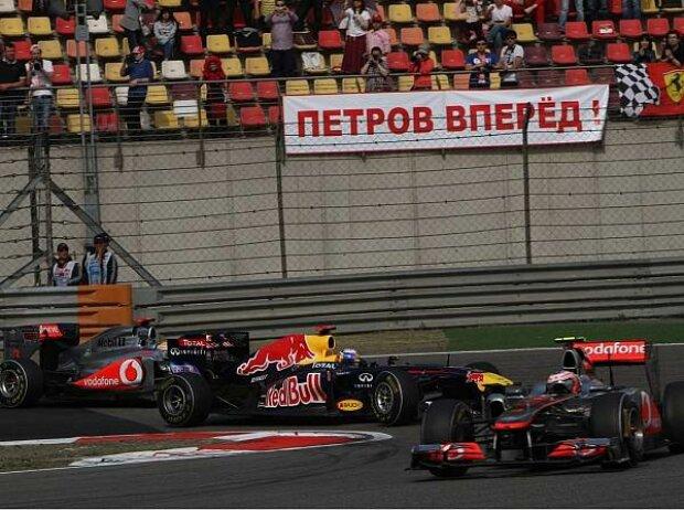 Jenson Button vor Sebastian Vettel und Lewis Hamilton