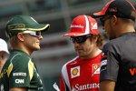 Heikki Kovalainen (Lotus), Fernando Alonso (Ferrari) und Lewis Hamilton (McLaren)
