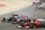 Fernando Alonso (Ferrari), Jenson Button (McLaren) und Kimi Räikkönen (Lotus)