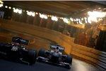 Heikki Kovalainen (Lotus) vor Sergio Perez (Sauber)