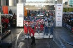 Sebastien Loeb (Citroen), Mikko Hirvonen (Citroen) und Petter Solberg (Ford) auf dem Podium der Rallye Neuseeland