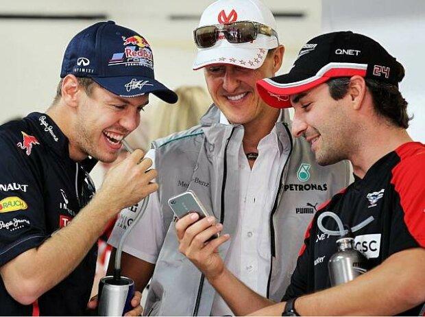 Sebastian Vettel, Michael Schumacher, Timo Glock