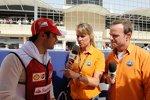 Fernando Alonso (Ferrari) mit Rubens Barrichello