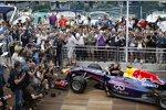 Sebastian Vettel (Red Bull) und Sebastien Ogier (Volkswagen)