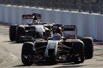 Romain Grosjean (Lotus) und Adrian Sutil (Sauber)