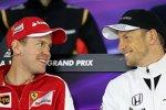 Sebastian Vettel (Ferrari) und Jenson Button (McLaren)