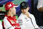 Nico Rosberg (Mercedes) und Sebastian Vettel (Ferrari)