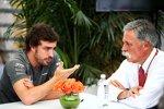 Fernando Alonso (McLaren) und Chase Carey