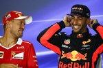 Sebastian Vettel (Ferrari) und Daniel Ricciardo (Red Bull)