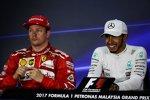 Lewis Hamilton (Mercedes) und Kimi Räikkönen (Ferrari)