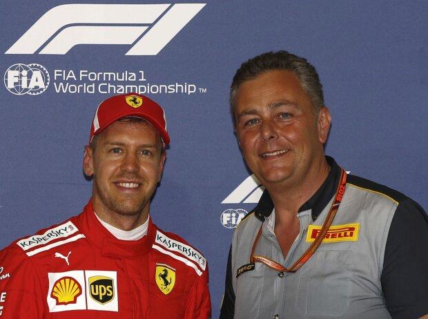 Sebastian Vettel und Mario Isola