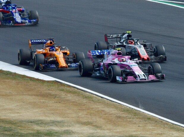 Esteban Ocon, Kevin Magnussen, Fernando Alonso