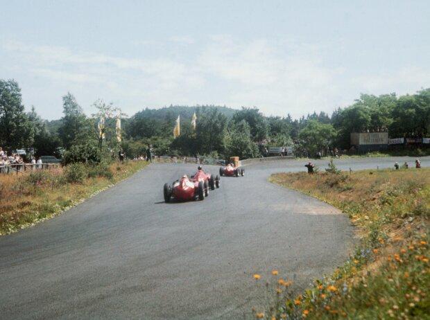 Mike Hawthorn, Juan Manuel Fangio, Peter Collins