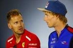 Sebastian Vettel (Ferrari) und Brendon Hartley (Toro Rosso)