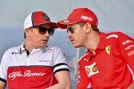 Kimi Räikkönen (Alfa Romeo) und Sebastian Vettel (Ferrari)