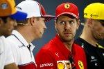 Sebastian Vettel (Ferrari) und Kimi Räikkönen (Alfa Romeo)