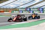 Carlos Sainz (Ferrari) und Daniel Ricciardo (McLaren)