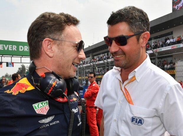 Red-Bull-Teamchef Christian Horner im Gespräch mit FIA-Rennleiter Michael Masi