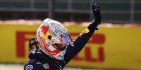 Max Verstappen winkt im Rennanzug