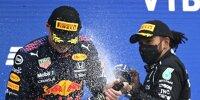 Max Verstappen (Red Bull) und Lewis Hamilton (Mercedes) auf dem Podium beim Formel-1-Rennen in Russland 2021