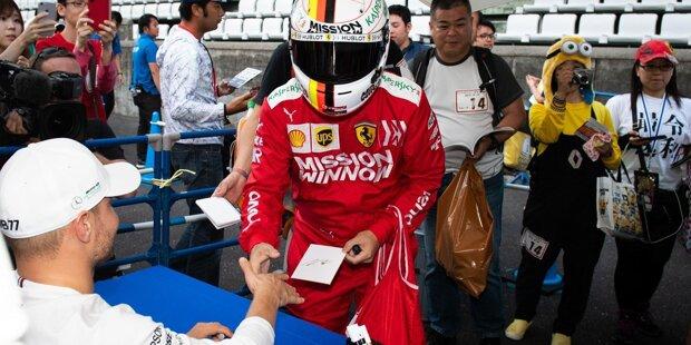 Ist das etwa ...? Nein, das ist natürlich nicht der echte Sebastian Vettel sondern ein Fan, der sich hier ein Autogramm bei Valtteri Bottas holt - glauben wir zumindest! Auf jeden Fall ist dieses Bild bei den besten Schnappschüssen des Japan-GP 2019 ganz weit vorne.